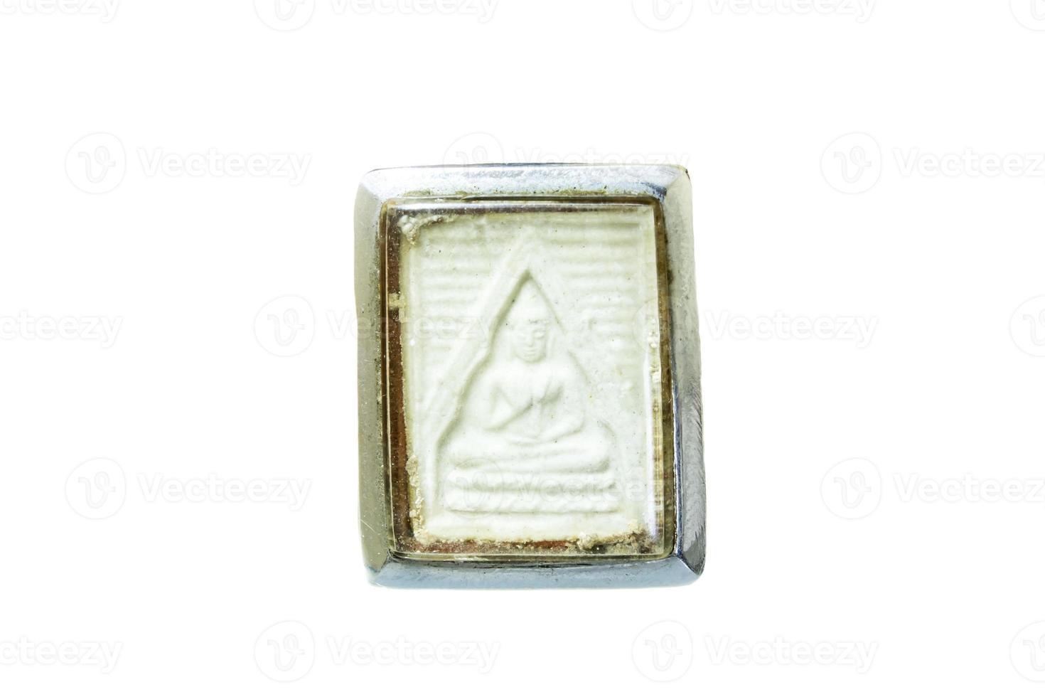oud amulet dat op wit wordt geïsoleerd foto