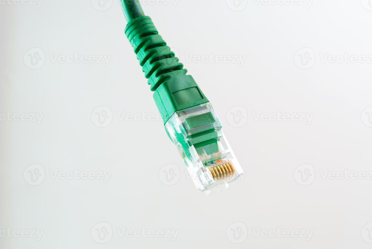 netwerkkabel rj45 hoofd op witte achtergrond foto