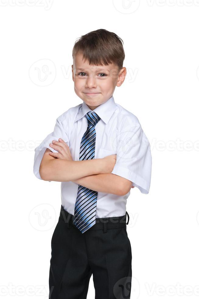zelfverzekerde schooljongen foto