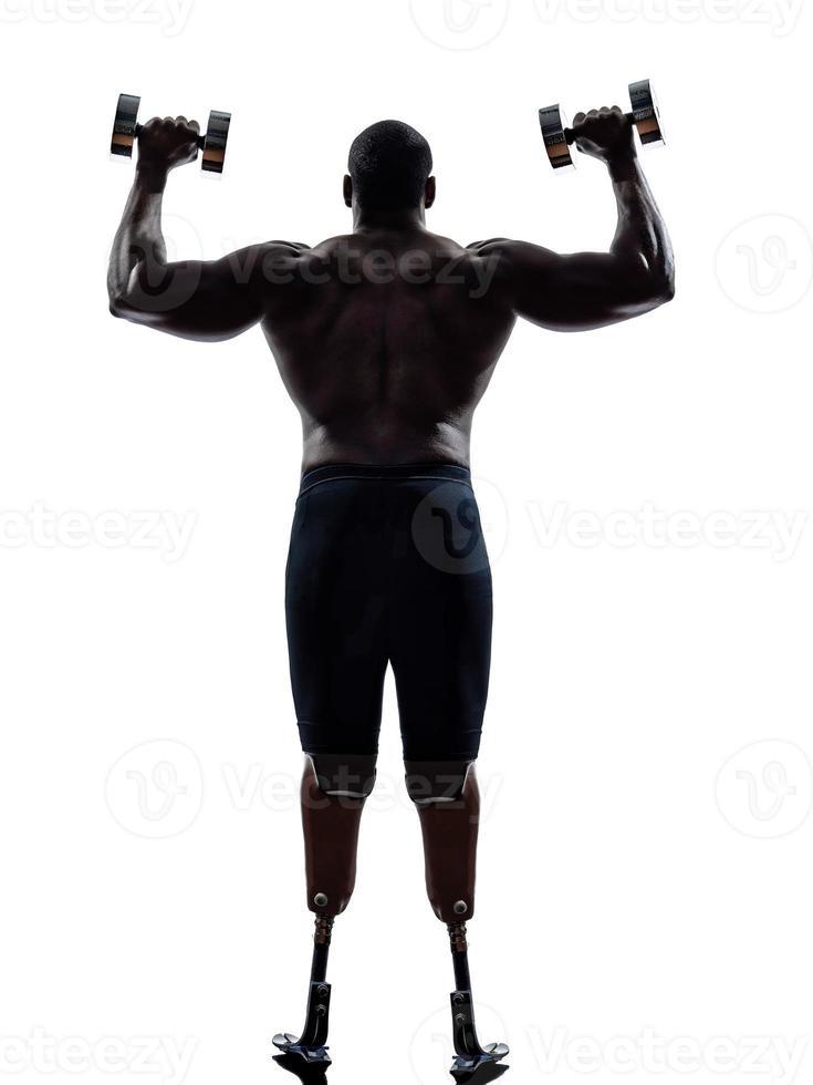 gehandicapte bodybuilders bouwen van gewichten man met benen prothese foto