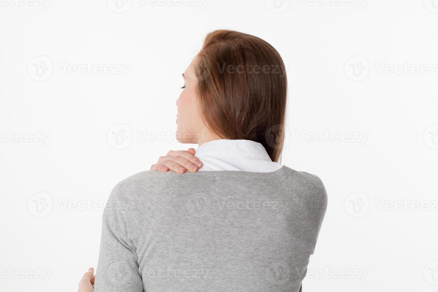 20s vrouw in achteraanzicht met vermoeidheid en spanning van het lichaam foto