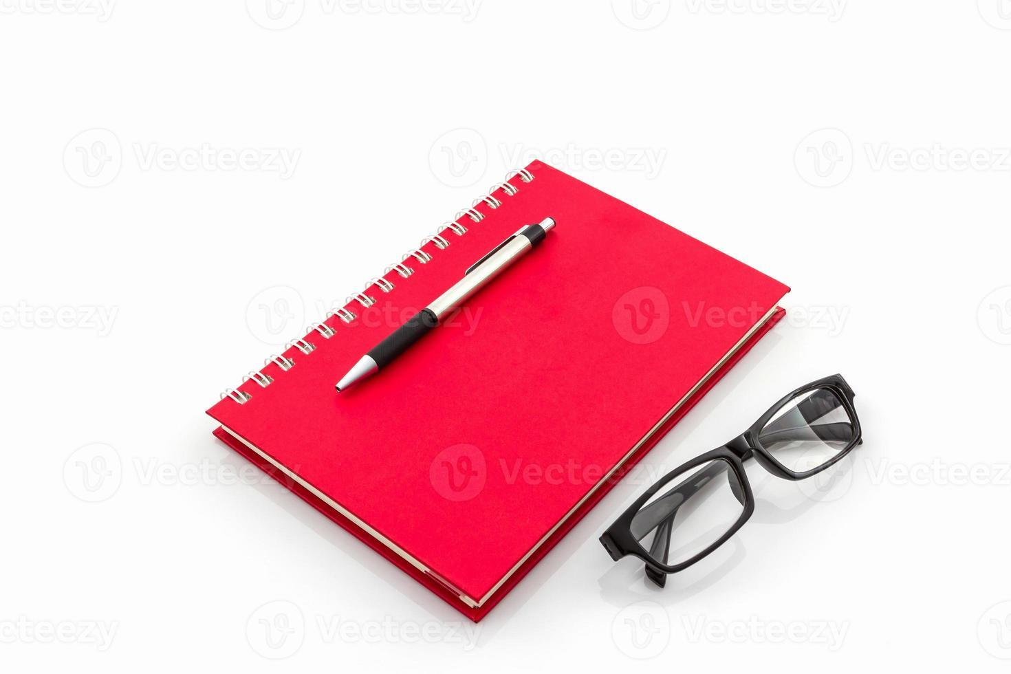 "rood dagboekboek met het woord ""professional"". foto"