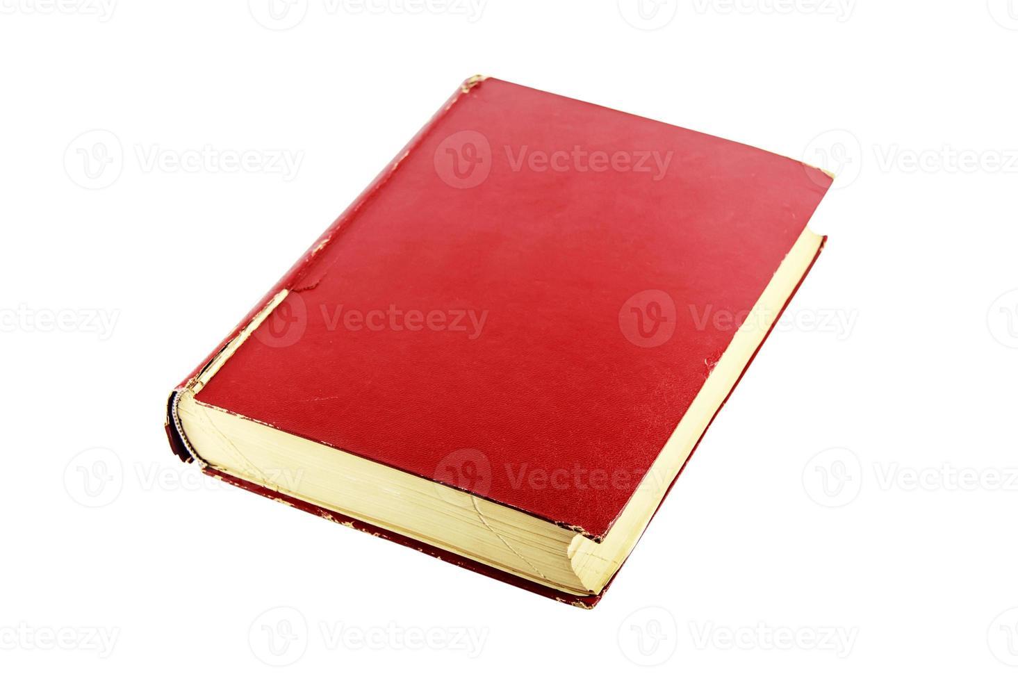 oud rood boek dat op wit wordt geïsoleerd foto