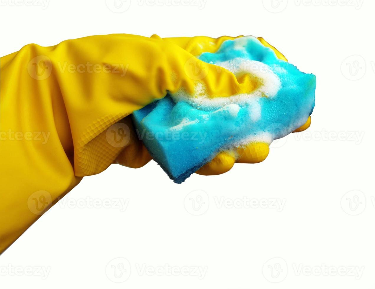 schoonmaakspons en beschermende rubberen handschoenen foto