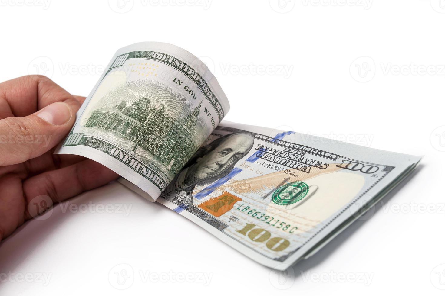 hand met $ 100 foto