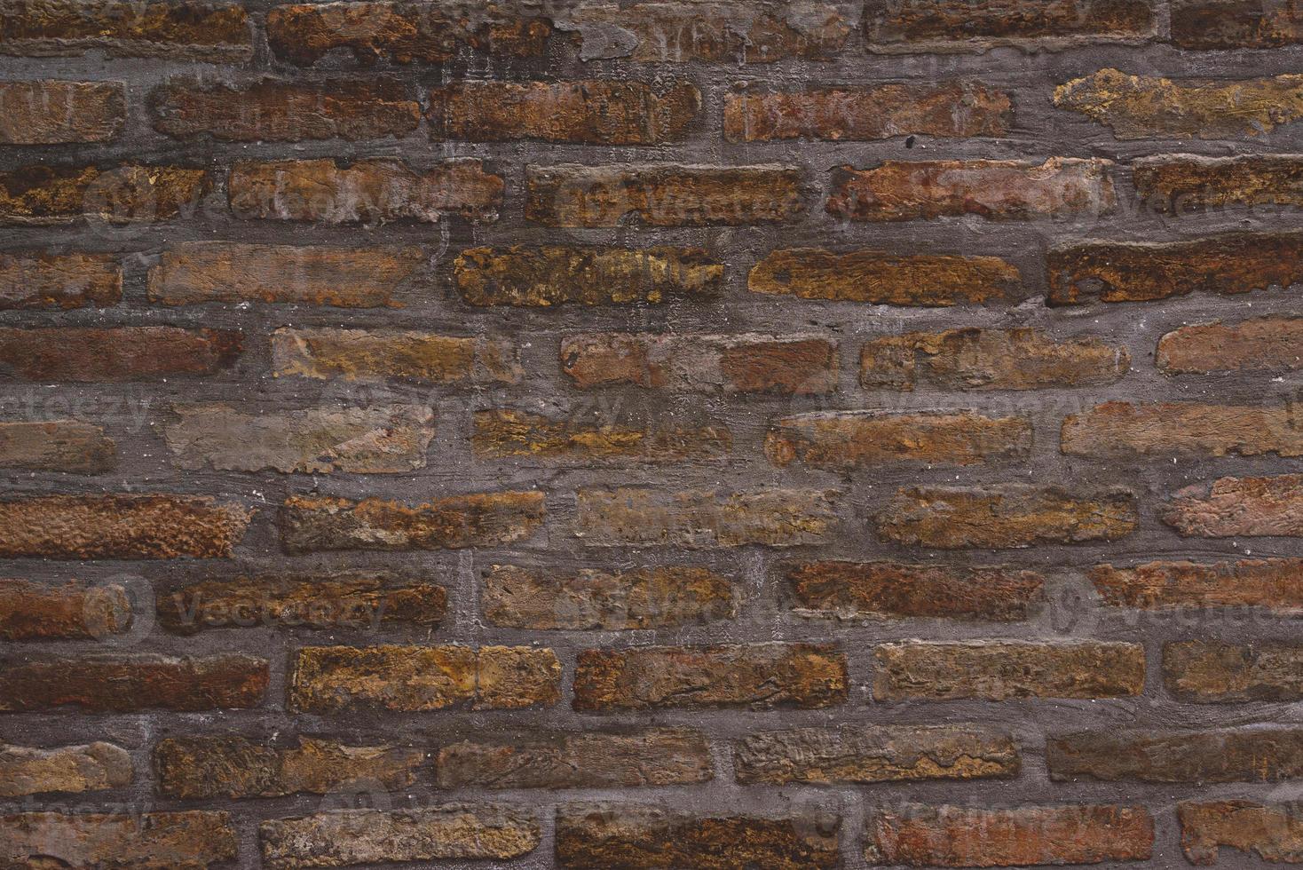 achtergrondpatroon van oude bakstenen muurtextuur foto