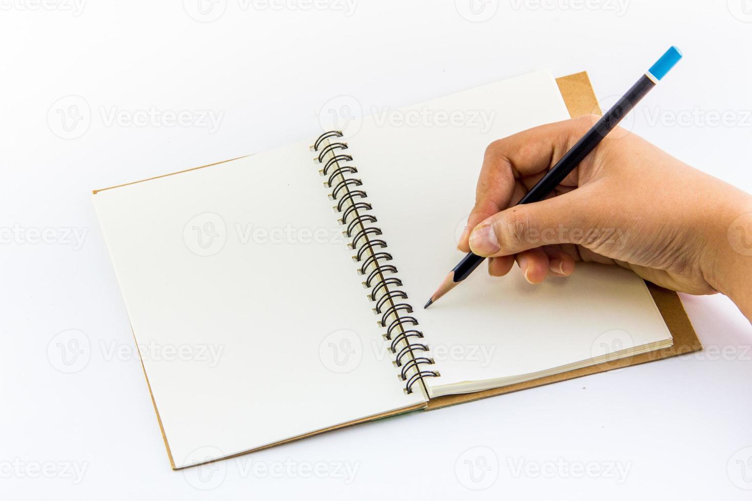 hand schrijven op laptop foto