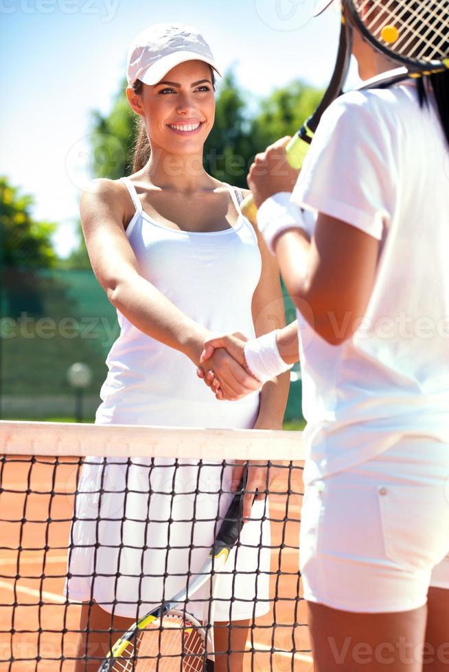 tennissers handen schudden foto