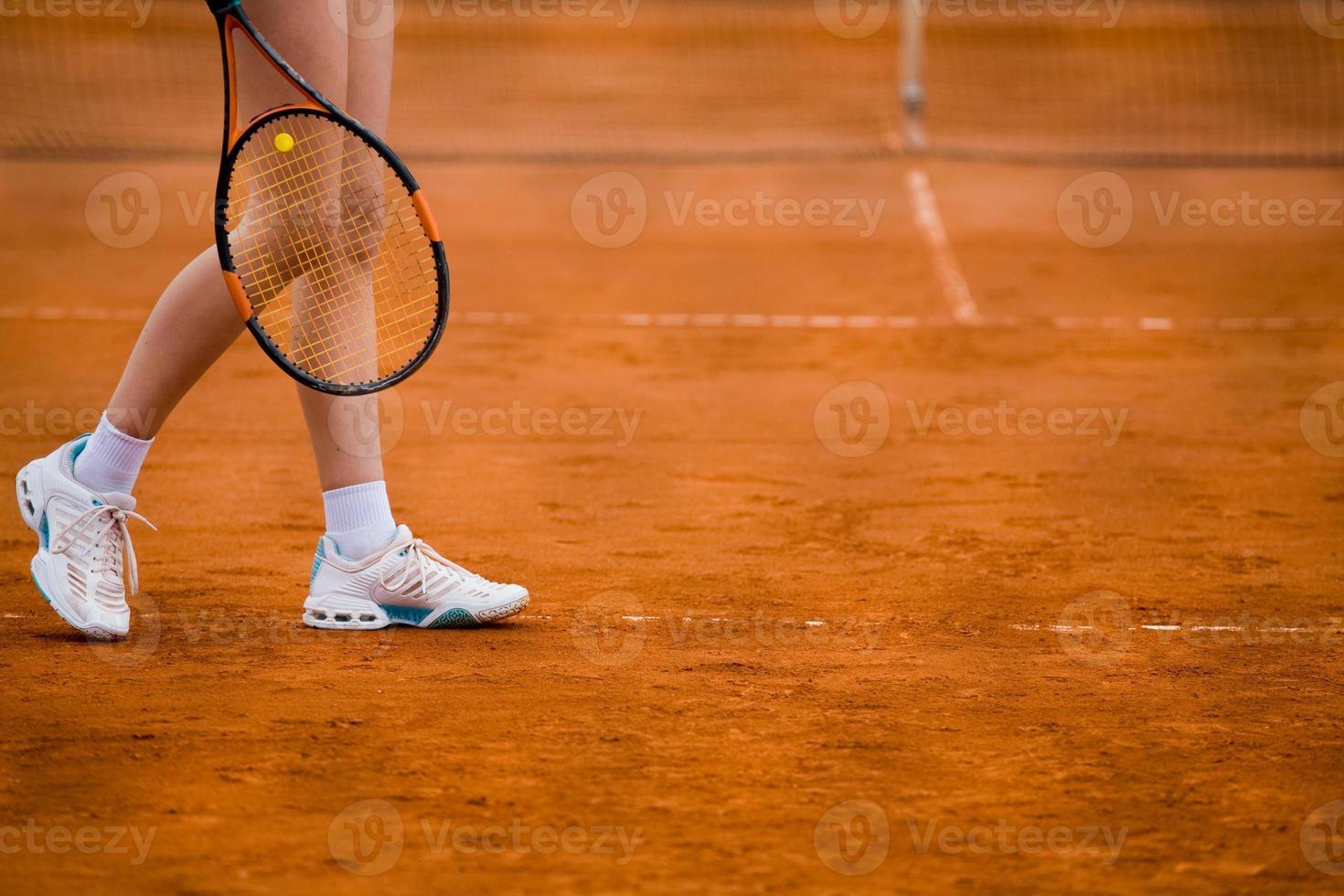 klei tennisbaan en speler concept foto