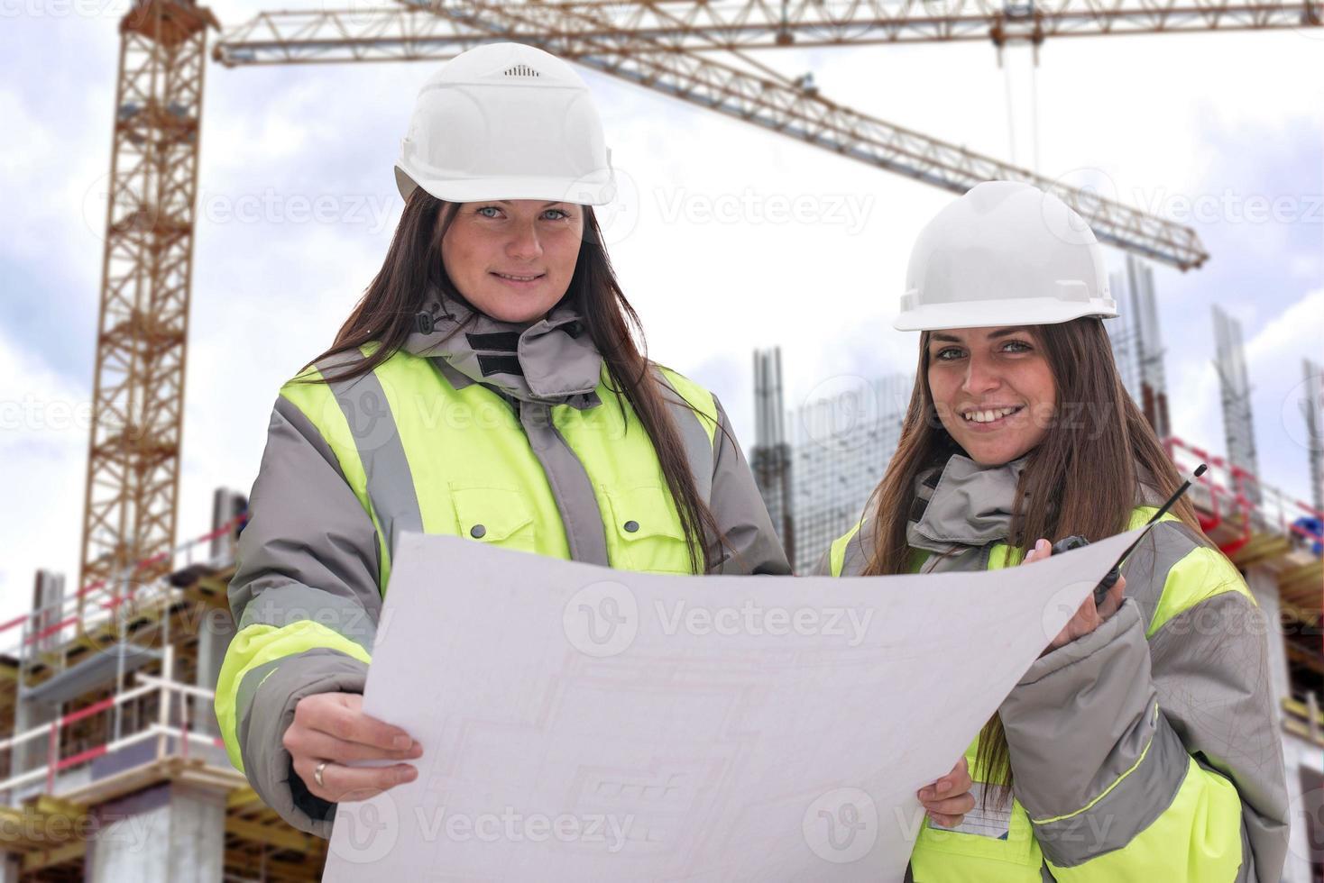 burgerlijk ingenieurs op de bouwplaats foto