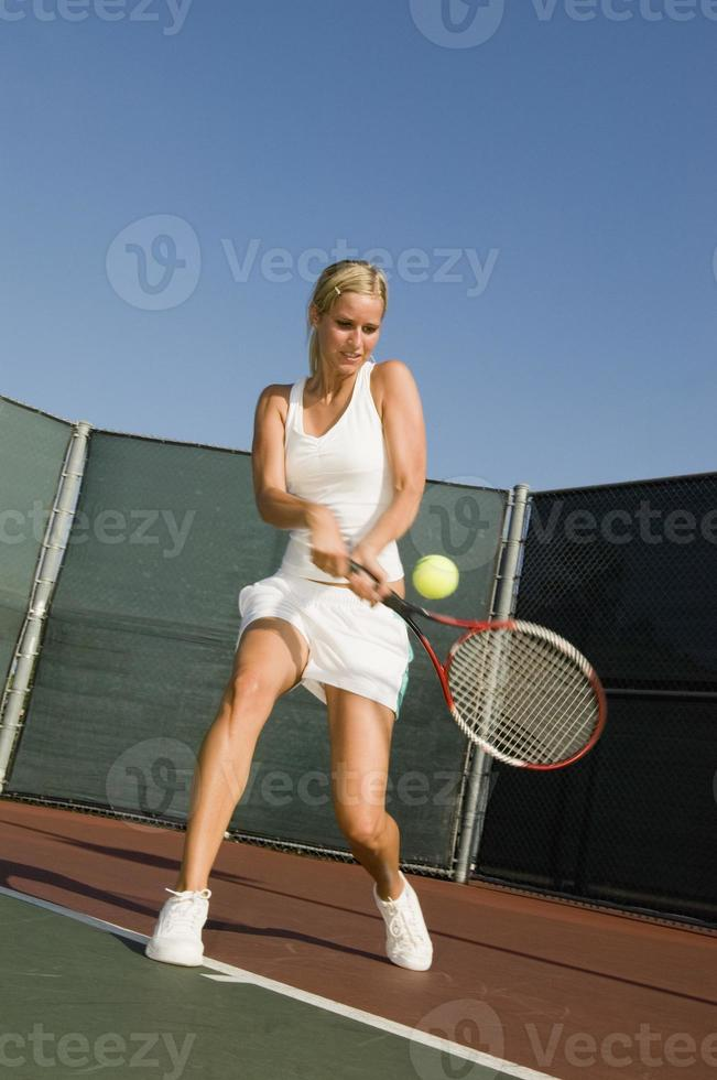 tennisser backhand raken foto
