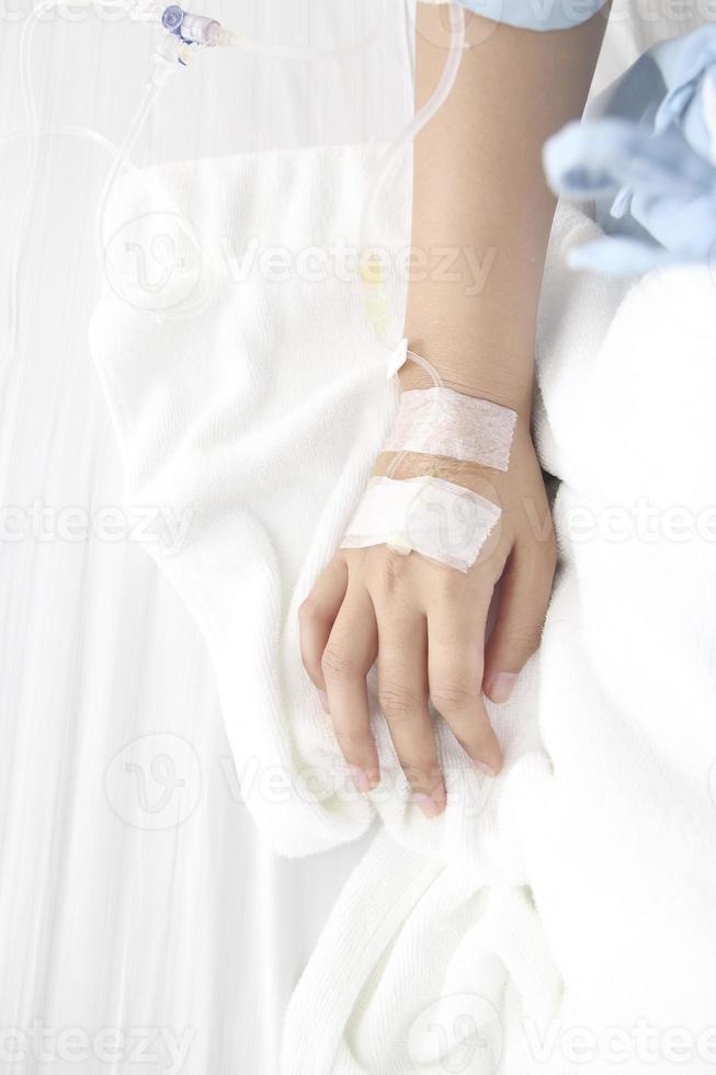 hand van de patiënt foto
