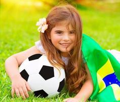 schattige kleine voetbalfan foto
