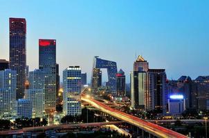 Peking na zonsondergang-nachtscène van cbd foto