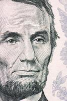het gezicht van Lincoln de macro van de dollarrekening foto