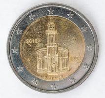 twee euromunt met Duitse achterkant gebruikte look foto
