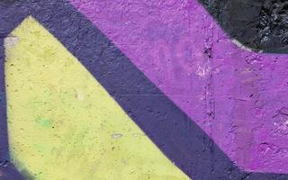 achtergrond muur violet geel, zwart, helder blauw, gevel foto