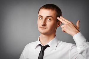 zakenman zelfmoord gebaar in een bedrijf foto