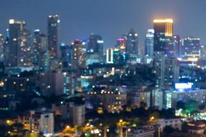nachtverlichting van wazig stadsgezicht, abstracte achtergrond foto
