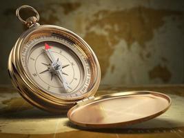 kompas op de achtergrond van de wereldkaart. navigatie. foto