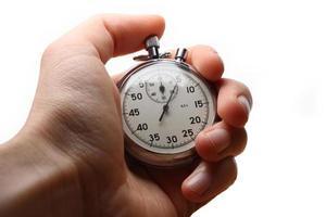 mannelijke hand met stopwatch foto