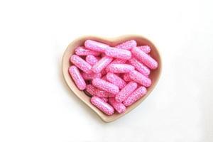 roze capsule foto