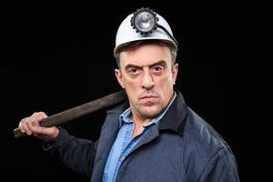 mijnwerker met een voorhamer foto