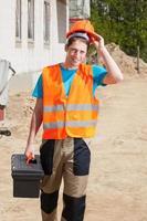 werknemer op de bouwplaats foto