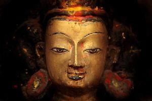 gouden Boeddha gezicht - Nepal, Kathmandu foto