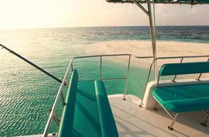 turquoise jacht in de Maldiven