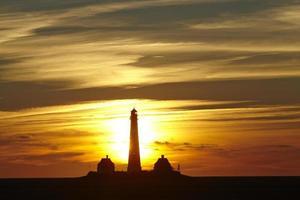 westerhever (duitsland) - vuurtoren bij zonsondergang foto