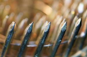 macro van rechtop bekijken gebruikte stapel nagels pistool foto