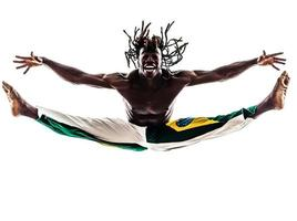 Braziliaanse zwarte man danser dansen capoeira silhouet foto