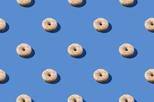 vanille witte donuts in een naadloos patroon foto