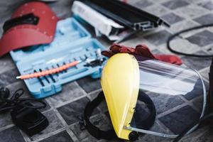 beschermend gelaatsscherm en veiligheidsuitrusting foto