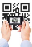 QR-code scannen geïsoleerd op wit foto