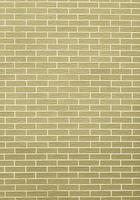 close-up van geelgroene bakstenen muur als achtergrond of textuur