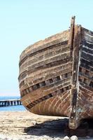 schipbreuk op het zand (voorkant)