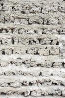 witte bakstenen muur. grungy witte betonnen wand foto