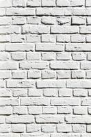 fragment van witte bakstenen muur foto