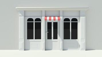 zonnige winkelpui met grote ramen met witte winkelgevel foto