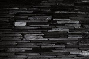 zwarte stenen muur foto