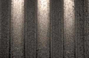 textuur van gegolfd roestvrij staalplaat getint sepia foto
