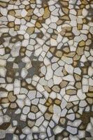 bruine, witte, grijze tegels mozaïek achtergrond.