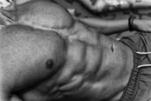 close-up van een aantrekkelijk lichaam in sauna foto