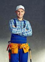 gelukkige jonge bouwvakker foto