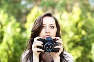 mooie vrouw fotograaf foto