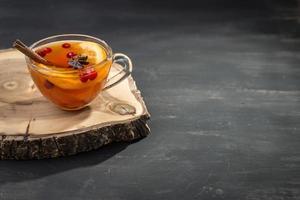 hete thee met sinaasappel foto