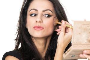 zakenvrouw met een make-up spiegel