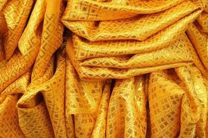 gouden stof textuur voor achtergrond foto